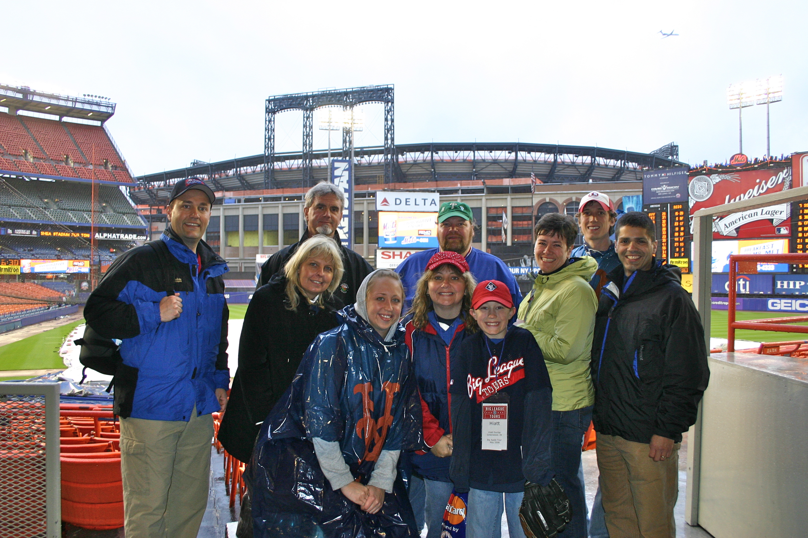 Our tour group huddled up at Shea Stadium w Citi Field in the background